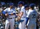 Mar 31, 2019; Los Angeles, CA, USA;    Los Angeles Dodgers second baseman Max Muncy (13) and center fielder Enrique Hernandez (14) and center fielder Cody Bellinger (35) talk with starting pitcher Walker Buehler (21) after a wild pitch allows a run to score in the fourth inning against the Arizona Diamondbacks at Dodger Stadium. Mandatory Credit: Jayne Kamin-Oncea-USA TODAY Sports