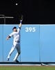 Mar 31, 2019; Los Angeles, CA, USA; Los Angeles Dodgers center fielder A.J. Pollock (11) leaps for a triple hit over his head by Arizona Diamondbacks shortstop Ketel Marte (4) in the eighth inning of the game at Dodger Stadium. Mandatory Credit: Jayne Kamin-Oncea-USA TODAY Sports