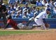 Mar 31, 2019; Los Angeles, CA, USA; Arizona Diamondbacks shortstop Ketel Marte (4) beats the throw to Los Angeles Dodgers third baseman Max Muncy (13) for a triple in the eighth inning of the game at Dodger Stadium. Mandatory Credit: Jayne Kamin-Oncea-USA TODAY Sports