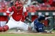 Apr 1, 2019; Cincinnati, OH, USA; Cincinnati Reds catcher Tucker Barnhart (16) is unable to tag out Milwaukee Brewers left fielder Ryan Braun (8) as he slides into home plate safely in the first inning at Great American Ball Park. Mandatory Credit: Aaron Doster-USA TODAY Sports