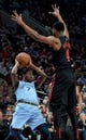 Apr 3, 2019; Portland, OR, USA; Portland Trail Blazers forward Maurice Harkless (4) plays some defense on Memphis Grizzlies forward Justin Holiday (7) during the first half of the game at the Moda Center. Mandatory Credit: Steve Dykes-USA TODAY Sports