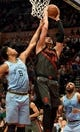 Apr 3, 2019; Portland, OR, USA; Portland Trail Blazers center Enes Kanter (00) grabs a rebound in front of Memphis Grizzlies forward Bruno Caboclo (5) and guard Jevon Carter (3) during the second half of the game at the Moda Center. The Blazers won 116-89. Mandatory Credit: Steve Dykes-USA TODAY Sports