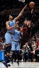 Apr 3, 2019; Portland, OR, USA;Portland Trail Blazers guard Seth Curry (31) drives to the basket on Memphis Grizzlies forward Bruno Caboclo (5) and Julian Washburn (4) during the second half of the game at the Moda Center. The Blazers won 116-89. Mandatory Credit: Steve Dykes-USA TODAY Sports