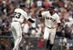Apr 6, 2019; San Francisco, CA, USA; San Francisco Giants Brandon Belt (right) celebrates with third base coach Ron Wotus (23) during the fifth inning against the Tampa Bay at Oracle Park. Mandatory Credit: D. Ross Cameron-USA TODAY Sports