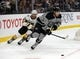 April 6, 2019; Los Angeles, CA, USA; Los Angeles Kings defenseman Sean Walker (61) moves the puck ahead of Vegas Golden Knights center Brandon Pirri (73) during the first period at Staples Center. Mandatory Credit: Gary A. Vasquez-USA TODAY Sports