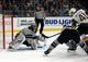 April 6, 2019; Los Angeles, CA, USA; Los Angeles Kings goaltender Jonathan Quick (32) blocks a shot against Vegas Golden Knights center Pierre-Edouard Bellemare (41) during the first period at Staples Center. Mandatory Credit: Gary A. Vasquez-USA TODAY Sports