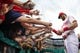 Apr 9, 2019; Philadelphia, PA, USA; Philadelphia Phillies right fielder Bryce Harper (3) signs autographs for young fans in the stands prior to the game against the Washington Nationals at Citizens Bank Park. Mandatory Credit: Bill Streicher-USA TODAY Sports