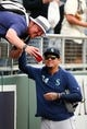 Apr 10, 2019; Kansas City, MO, USA; Seattle Mariners starting pitcher Felix Hernandez (34) takes a photo with a fan prior to the game against the Kansas City Royals at Kauffman Stadium. Mandatory Credit: Jay Biggerstaff-USA TODAY Sports