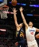 Apr 10, 2019; Los Angeles, CA, USA; Utah Jazz guard Grayson Allen (24) is defended by LA Clippers center Ivica Zubac (40) in the first half at Staples Center. Mandatory Credit: Kirby Lee-USA TODAY Sports