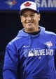 Apr 12, 2019; Toronto, Ontario, CAN; Toronto Blue Jays manager Charlie Montoyo (25) walks out of the dugout during batting practice against the Tampa Bay Rays at Rogers Centre. Mandatory Credit: Nick Turchiaro-USA TODAY Sports