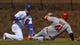 Apr 13, 2019; Chicago, IL, USA; Los Angeles Angels first baseman Justin Bour (41) is tagged out at second base by Chicago Cubs shortstop Javier Baez (9) in the first inning at Wrigley Field. Mandatory Credit: Matt Marton-USA TODAY Sports