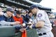 Apr 13, 2019; Seattle, WA, USA; Houston Astros third baseman Alex Bregman (2) signs autographs before a game against the Seattle Mariners at T-Mobile Park. Mandatory Credit: Joe Nicholson-USA TODAY Sports