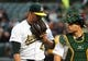 Apr 17, 2019; Oakland, CA, USA; Oakland Athletics starting pitcher Frankie Montas (47) speaks with catcher Josh Phegley (19) after the top of the first inning against the Houston Astros at Oakland Coliseum. Mandatory Credit: Kelley L Cox-USA TODAY Sports