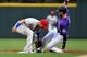Apr 18, 2019; Denver, CO, USA; Philadelphia Phillies second baseman Cesar Hernandez (16) tags out Colorado Rockies center fielder David Dahl (26) in the first inning against the Philadelphia Phillies at Coors Field. Mandatory Credit: Ron Chenoy-USA TODAY Sports