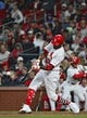 Apr 19, 2019; St. Louis, MO, USA; St. Louis Cardinals center fielder Dexter Fowler (25) hits a double against New York Mets relief pitcher Seth Lugo (not pictured) at Busch Stadium. Mandatory Credit: Jeff Curry-USA TODAY Sports