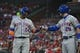 Apr 19, 2019; St. Louis, MO, USA; New York Mets second baseman Robinson Cano (24) is congratulated by third baseman J.D. Davis (28) after scoring during the first inning against the St. Louis Cardinals at Busch Stadium. Mandatory Credit: Jeff Curry-USA TODAY Sports