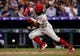 Apr 20, 2019; Denver, CO, USA; Philadelphia Phillies center fielder Roman Quinn (24) bunts to load the bases in the fourth inning against the Colorado Rockies at Coors Field. Mandatory Credit: Isaiah J. Downing-USA TODAY Sports