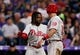 Apr 20, 2019; Denver, CO, USA; Philadelphia Phillies center fielder Roman Quinn (24) celebrates with catcher J.T. Realmuto (10) after they scored on a play in the fourth inning against the Colorado Rockies at Coors Field. Mandatory Credit: Isaiah J. Downing-USA TODAY Sports
