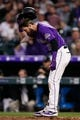 Apr 20, 2019; Denver, CO, USA; Colorado Rockies center fielder David Dahl (26) reacts after striking out in the fourth inning against the Philadelphia Phillies at Coors Field. Mandatory Credit: Isaiah J. Downing-USA TODAY Sports