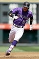 Apr 24, 2019; Denver, CO, USA; Colorado Rockies shortstop Trevor Story (27) runs to third on a triple in the third inning against the Washington Nationals at Coors Field. Mandatory Credit: Isaiah J. Downing-USA TODAY Sports