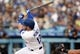 April 27, 2019; Los Angeles, CA, USA; Los Angeles Dodgers first baseman Max Muncy (13) hits a single against the Pittsburgh Pirates during the second inning at Dodger Stadium. Mandatory Credit: Gary A. Vasquez-USA TODAY Sports