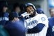 Apr 27, 2019; Seattle, WA, USA; Seattle Mariners left fielder Domingo Santana (16) celebrates in the dugout after hitting a solo home run against the Texas Rangers during the first inning at T-Mobile Park. Mandatory Credit: Jennifer Buchanan-USA TODAY Sports