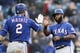 Apr 27, 2019; Seattle, WA, USA; Texas Rangers first baseman Danny Santana (right) gets a high-five for catcher Jeff Mathis (2) after Santana came around to score against the Seattle Mariners during the third inning at T-Mobile Park. Mandatory Credit: Jennifer Buchanan-USA TODAY Sports