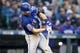 Apr 27, 2019; Seattle, WA, USA; Texas Rangers third baseman Logan Forsythe (41) hits an RBI single against the Seattle Mariners during the fifth inning at T-Mobile Park. Mandatory Credit: Jennifer Buchanan-USA TODAY Sports