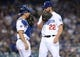 April 27, 2019; Los Angeles, CA, USA; Los Angeles Dodgers starting pitcher Clayton Kershaw (22) speaks with catcher Austin Barnes (15) during a stoppage in play in the seventh inning at Dodger Stadium. Mandatory Credit: Gary A. Vasquez-USA TODAY Sports