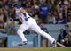 April 27, 2019; Los Angeles, CA, USA; Los Angeles Dodgers first baseman Max Muncy (13) reaches first on a single against the Pittsburgh Pirates during the seventh inning at Dodger Stadium. Mandatory Credit: Gary A. Vasquez-USA TODAY Sports