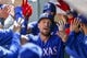 Apr 28, 2019; Seattle, WA, USA; Texas Rangers left fielder Hunter Pence (24) is greeted in the dugout following a two-run home run against the Seattle Mariners during the third inning at T-Mobile Park. Mandatory Credit: Joe Nicholson-USA TODAY Sports