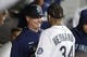 Apr 30, 2019; Seattle, WA, USA; Seattle Mariners manager Scott Servais (29) talks with starting pitcher Felix Hernandez (34) following the sixth inning against the Chicago Cubs at T-Mobile Park. Mandatory Credit: Joe Nicholson-USA TODAY Sports