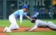 May 1, 2019; Kansas City, MO, USA; Tampa Bay Rays center fielder Kevin Kiermaier (39) steals second base as Kansas City Royals right fielder Whit Merrifield (15) reaches for the ball during the seventh inning in the first game of a baseball doubleheader at Kauffman Stadium. Mandatory Credit: Jay Biggerstaff-USA TODAY Sports