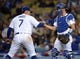 May 10, 2019; Los Angeles, CA, USA; Los Angeles Dodgers relief pitcher Julio Urias (7) and catcher Austin Barnes (15) celebrate the 5-0 victory against the Washington Nationals at Dodger Stadium. Mandatory Credit: Gary A. Vasquez-USA TODAY Sports
