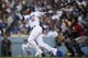 May 11, 2019; Los Angeles, CA, USA; Los Angeles Dodgers third baseman Justin Turner (10) follows through on a swing for a two-run home run during the third inning against the Washington Nationals at Dodger Stadium. Mandatory Credit: Kelvin Kuo-USA TODAY Sports