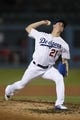 May 11, 2019; Los Angeles, CA, USA; Los Angeles Dodgers starting pitcher Walker Buehler (21) pitches during the seventh inning against the Washington Nationals at Dodger Stadium. Mandatory Credit: Kelvin Kuo-USA TODAY Sports