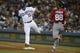 May 11, 2019; Los Angeles, CA, USA; Los Angeles Dodgers third baseman Max Muncy (13) forces out Washington Nationals first baseman Gerardo Parra (88) at first base during the seventh inning at Dodger Stadium. Mandatory Credit: Kelvin Kuo-USA TODAY Sports