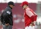 May 16, 2019; Cincinnati, OH, USA; Cincinnati Reds manager David Bell (right) talks with third base umpire Roberto Ortiz (40) during the first inning against the Chicago Cubs at Great American Ball Park. Mandatory Credit: David Kohl-USA TODAY Sports