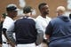 May 19, 2019; Detroit, MI, USA; Detroit Tigers shortstop Niko Goodrum (middle) is examined by third base coach Dave Clark (left) and manager Ron Gardenhire (middle left) and a trainer after sliding in head first on a hit for a triple in the first inning against the Oakland Athletics at Comerica Park. Mandatory Credit: Rick Osentoski-USA TODAY Sports