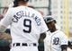 May 19, 2019; Detroit, MI, USA; Detroit Tigers first baseman Niko Goodrum (28) is congratulated by right fielder Nicholas Castellanos (9) after scoring in the first inning against the Oakland Athletics at Comerica Park. Mandatory Credit: Rick Osentoski-USA TODAY Sports