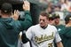 May 19, 2019; Detroit, MI, USA; Oakland Athletics third baseman Matt Chapman (26) is congratulated by teammates after scoring in the third inning against the Detroit Tigers at Comerica Park. Mandatory Credit: Rick Osentoski-USA TODAY Sports
