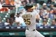 May 19, 2019; Detroit, MI, USA; Oakland Athletics right fielder Stephen Piscotty (25) hits an RBI single in the third inning against the Detroit Tigers at Comerica Park. Mandatory Credit: Rick Osentoski-USA TODAY Sports