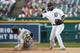 May 19, 2019; Detroit, MI, USA; Detroit Tigers shortstop Ronny Rodriguez (60) makes a throw to first base to complete a double play as Oakland Athletics third baseman Matt Chapman (26) slides into second base in the fifth inning at Comerica Park. Mandatory Credit: Rick Osentoski-USA TODAY Sports