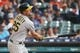 May 19, 2019; Detroit, MI, USA; Oakland Athletics right fielder Stephen Piscotty (25) hits a two RBI double in the seventh inning against the Detroit Tigers at Comerica Park. Mandatory Credit: Rick Osentoski-USA TODAY Sports
