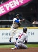May 19, 2019; Seattle, WA, USA; Seattle Mariners second baseman Dee Gordon (9) tags Minnesota Twins shortstop Jorge Polanco (11) out at second and makes the throw to first for the double play on Minnesota Twins designated hitter Jonathan Schoop (not pictured) in the first inning at T-Mobile Park. Mandatory Credit: Lindsey Wasson-USA TODAY Sports
