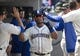 May 19, 2019; Seattle, WA, USA; Seattle Mariners first baseman Edwin Encarnacion (10) is greeted in the dugout after scoring on a double by Seattle Mariners left fielder Domingo Santana (not pictured) in the fourth inning against the Minnesota Twins at T-Mobile Park. Mandatory Credit: Lindsey Wasson-USA TODAY Sports