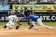 May 27, 2019; Chicago, IL, USA; Chicago White Sox catcher James McCann (33) is tagged out by Kansas City Royals shortstop Adalberto Mondesi (27) at second base during the second inning at Guaranteed Rate Field. Mandatory Credit: David Banks-USA TODAY Sports