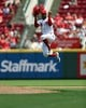 May 27, 2019; Cincinnati, OH, USA; Cincinnati Reds relief pitcher Amir Garrett (50) leaps as he takes the field against the Pittsburgh Pirates in the sixth inning at Great American Ball Park. Mandatory Credit: Aaron Doster-USA TODAY Sports