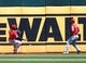 May 29, 2019; Oakland, CA, USA; Los Angeles Angels center fielder Brian Goodwin (18) and right fielder Kole Calhoun (56) gather the ball along the ball against the Oakland Athletics during the fifth inning at Oakland Coliseum. Mandatory Credit: Kelley L Cox-USA TODAY Sports