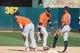 Jun 2, 2019; Oakland, CA, USA; Houston Astros right fielder Josh Reddick (22) celebrates with third baseman Alex Bregman (2) and left fielder Tony Kemp (18) after a win against the Oakland Athletics in twelve innings at Oakland Coliseum. Mandatory Credit: Kelley L Cox-USA TODAY Sports